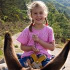 girl riding on donkey, donkey hiking in the Cevennes, France
