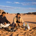 beduins having breakfast at campfire, Akakus mountains, Libya, Africa