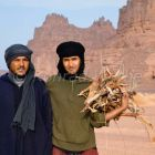 Tuaregs collecting firewood, Akakus mountains, Libya, Sahara, North Africa